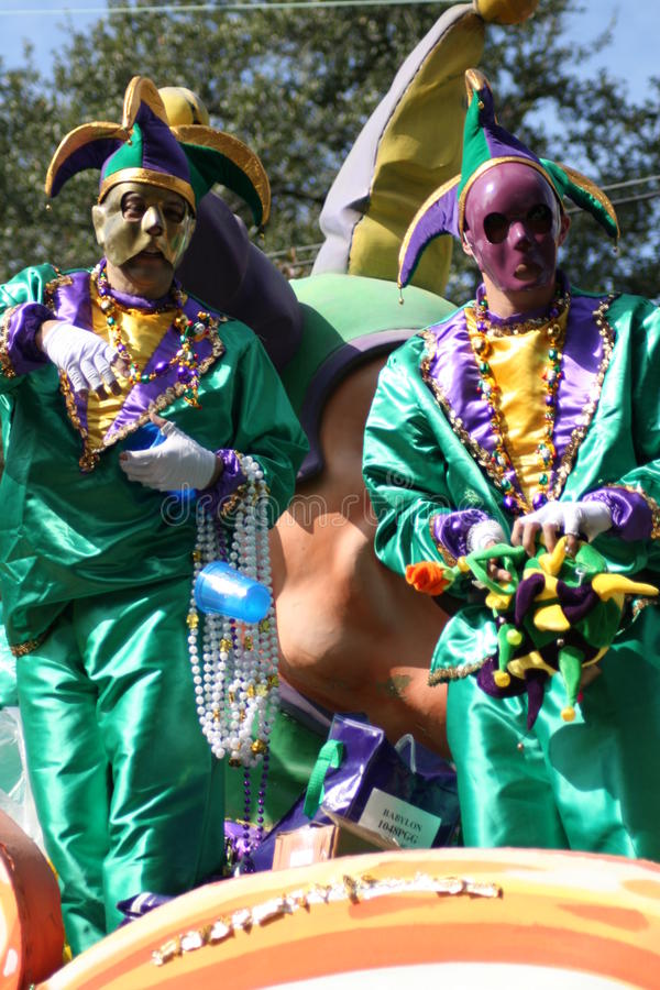 People celebrated crazily in Mardi Gras parade. NEW ORLEANS - FEBRUARY 2: People celebrated crazily in Mardi Gras parade. February 2, 2008 in New Orleans stock image