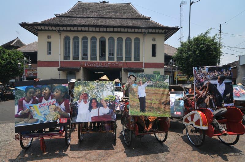 People CelebrateThe Inaguration of Indonesian New President. SURAKARTA, INDONESIA - October 20 : Residents carrying a big poster of Indonesian new president royalty free stock image