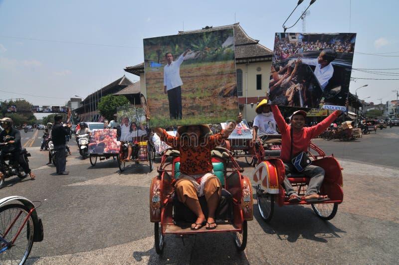 People CelebrateThe Inaguration of Indonesian New President. SURAKARTA, INDONESIA - October 20 : Residents carrying a big poster of Indonesian new president stock photography