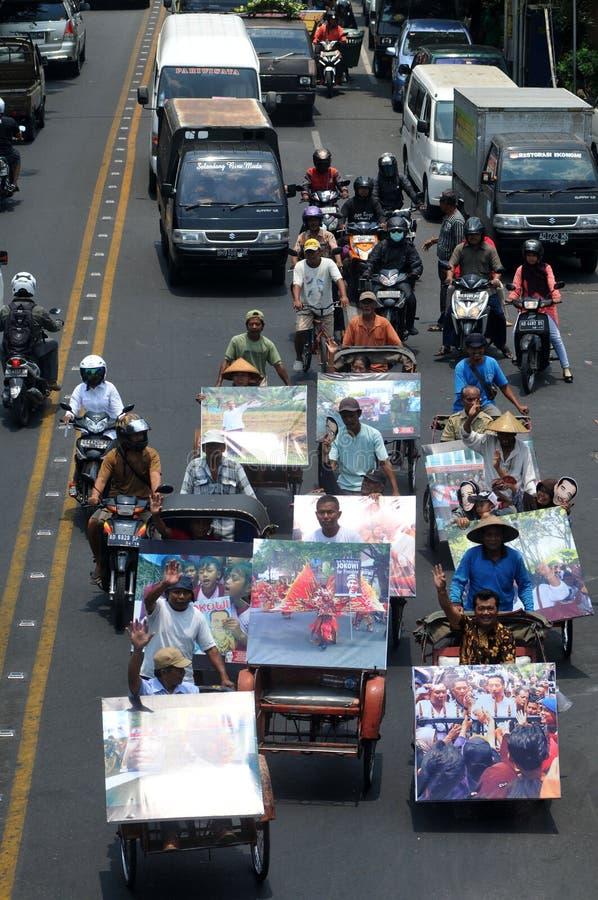 People CelebrateThe Inaguration of Indonesian New President. SURAKARTA, INDONESIA - October 20 : Residents carrying a big poster of Indonesian new president stock photos