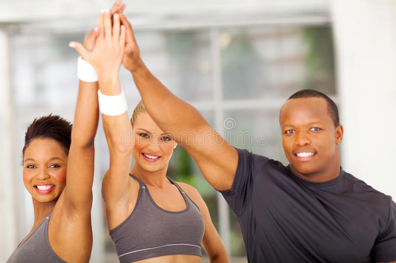 People celebrating exercise. Group of healthy people celebrating after exercise stock photo
