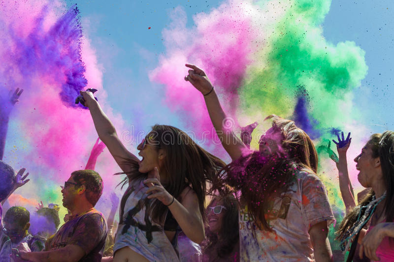 People celebrating Holi Festival of Colors. royalty free stock images