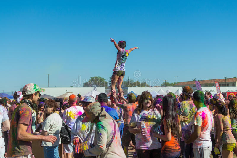 People celebrating Holi Festival of Colors. stock images