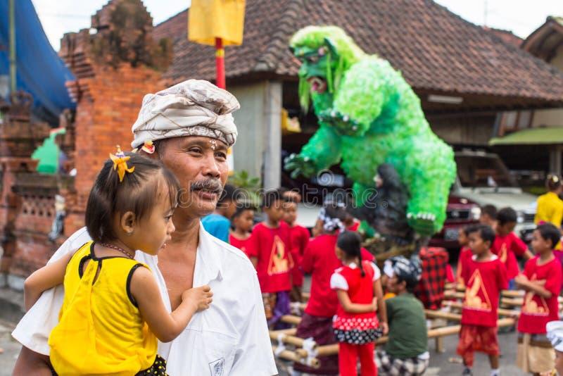 People during the celebration before Nyepi - Balinese Day of Silence. UBUD, BALI - MAR 8, 2016: Unidentified people during the celebration before Nyepi royalty free stock photography