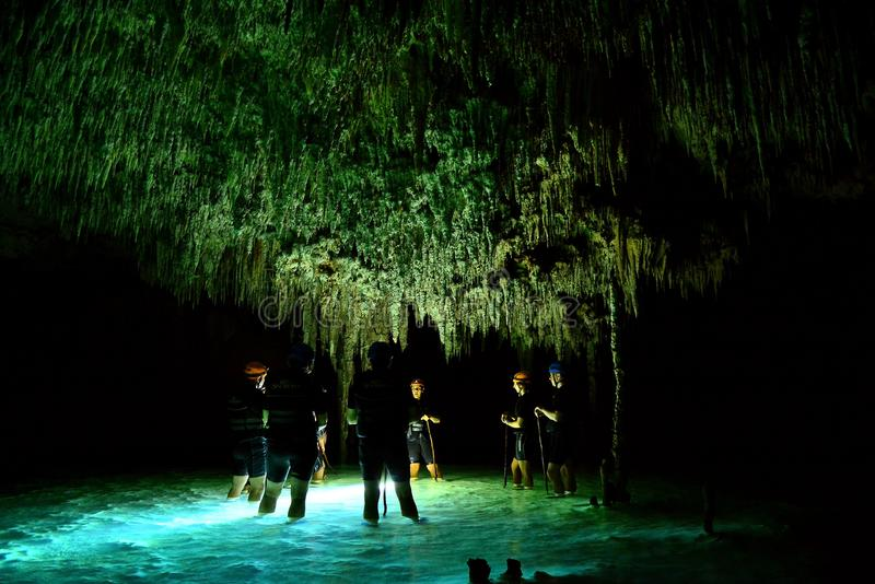 People in cenote cave with underground water system at Rio secreto, Mexico royalty free stock photography