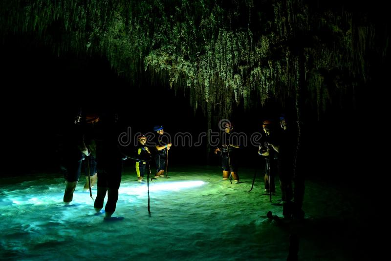 People in cenote cave with underground water system rio secreto, Mexico. Cenote cave with underground water system rio secreto in Mexico stock image