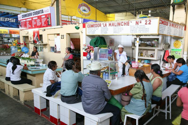 People on a central Oaxaca market eating on a market food court. OAXACA, MEXICO - MARCH 6th, 2012: People on a central Oaxaca market eating on a market food royalty free stock image
