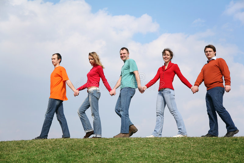 People chain go on meadow royalty free stock photos