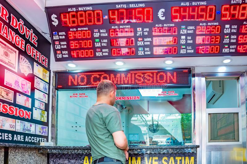 People change currency at money changer shop. Unidentified people change currency at money changer shop in Istanbul, Turkey.26 May 2018 royalty free stock photo