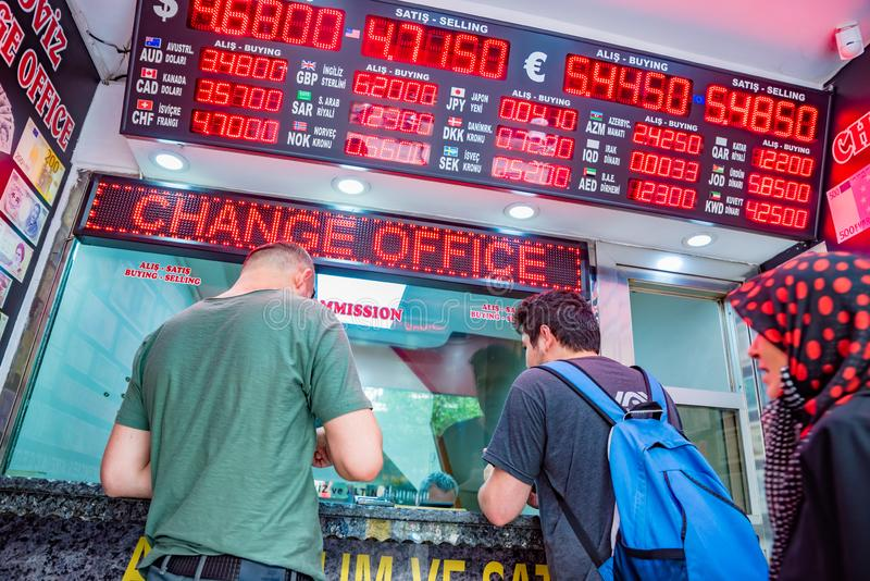 People change currency at money changer shop. Unidentified people change currency at money changer shop in Istanbul, Turkey.26 May 2018 stock images