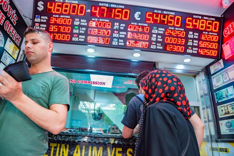 People change currency at money changer shop. Unidentified people change currency at money changer shop in Istanbul, Turkey.26 May 2018 stock photography