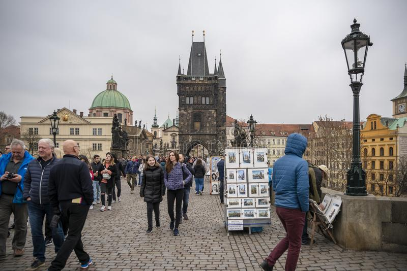 "People on Charles Bridge in Prague. Prague, capital city of the Czech Republic, is bisected by the Vltava River. Nicknamed ""the City of a Hundred Spires stock photos"