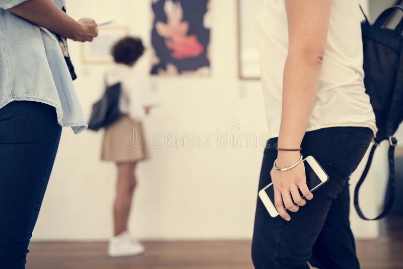 People checking out the art exhibition royalty free stock images