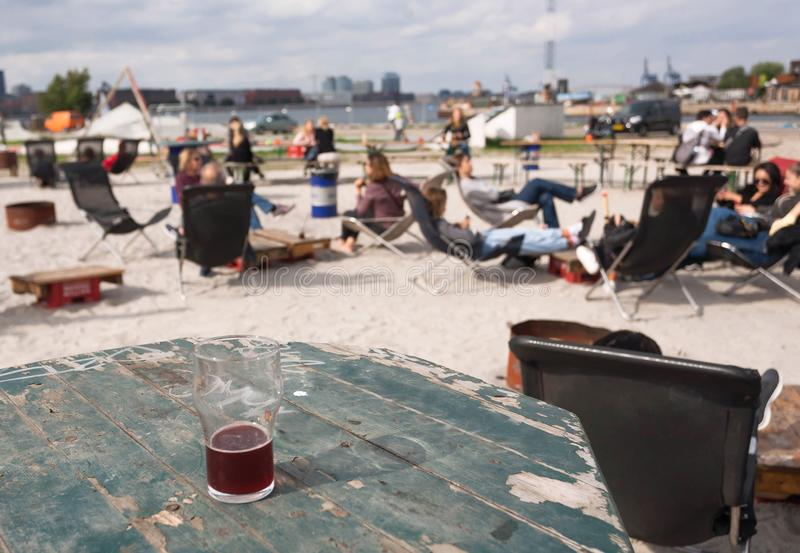 People chilling with beer and food at fast food street market in Copenhagen, Denmark. Leisure and outdoor activity. People chilling with beer and food at fast stock photo