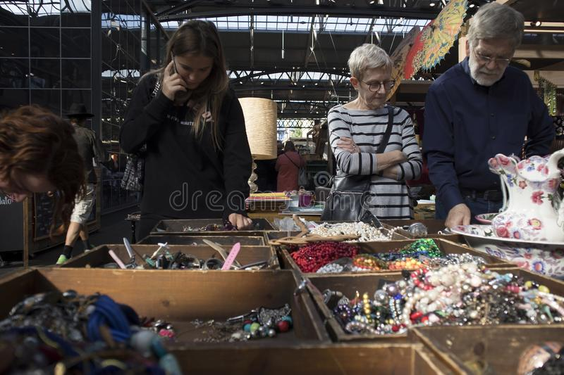 People choose jewelry in boxes with cheap rings and beads royalty free stock photo