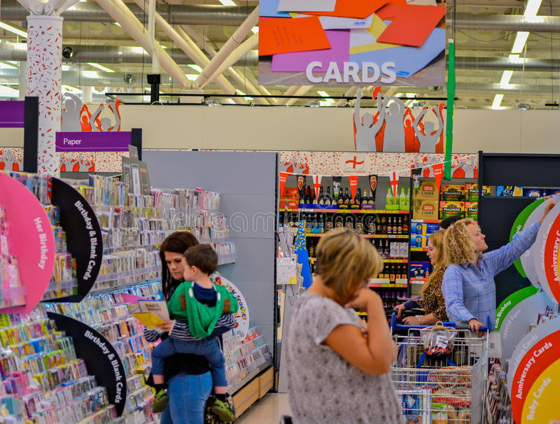 People choosing cards. A picture of people choosing cards in a supermarket stock photography
