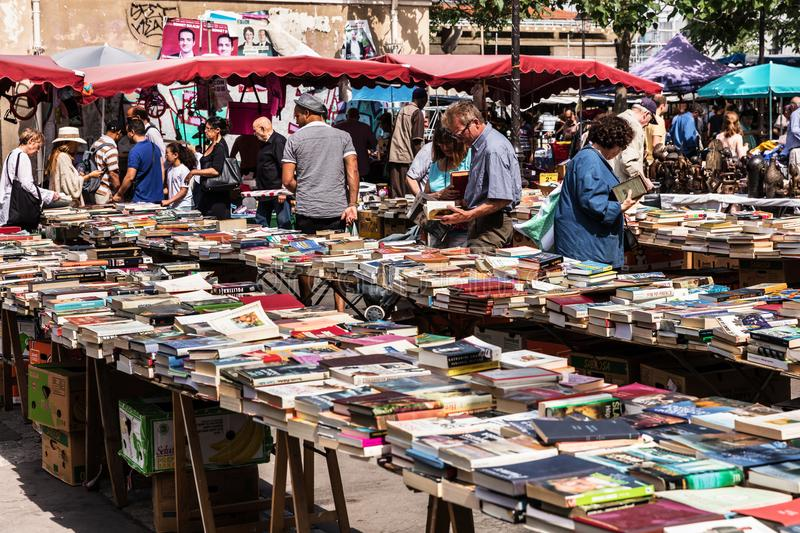 People choosing used books at the flea Aligre Market. Paris, France stock photography