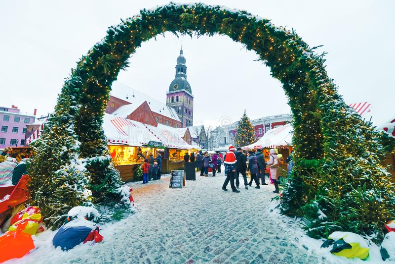 People Christmas market Dome Square Xmas tree Riga snow stock photography