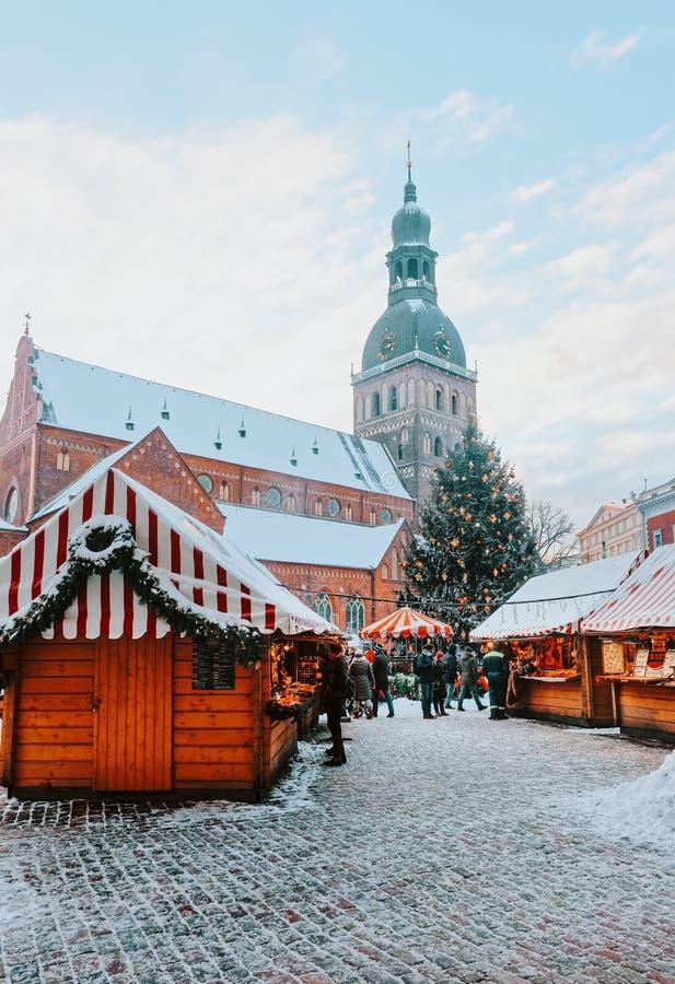 People Christmas market Dome Square Xmas tree snow Riga royalty free stock photography