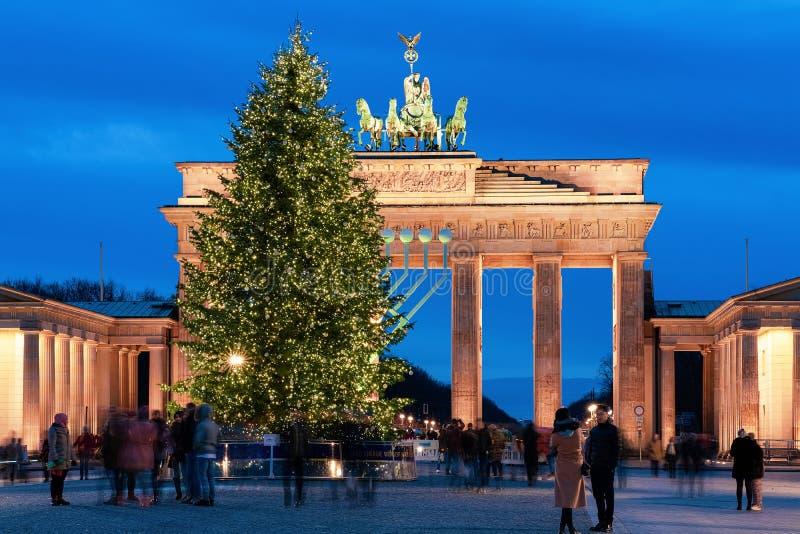 People Christmas tree Brandenburg gate Parizer Platz Street night Berlin stock photo