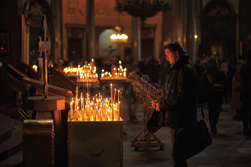 People in the church and light candles. Kazan Cathedral, St. Petersburg, Russia royalty free stock photography