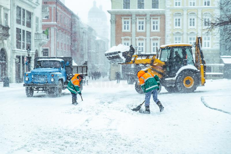 People cleaning city streets after snowstorm royalty free stock photos