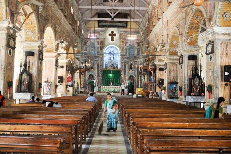 People cleaning the interior of Santa Cruz Cathedral. KOCHI, INDIA - JANUARY 16, 2015: People cleaning the interior of Santa Cruz Cathedral at Fort Cochin on royalty free stock photos