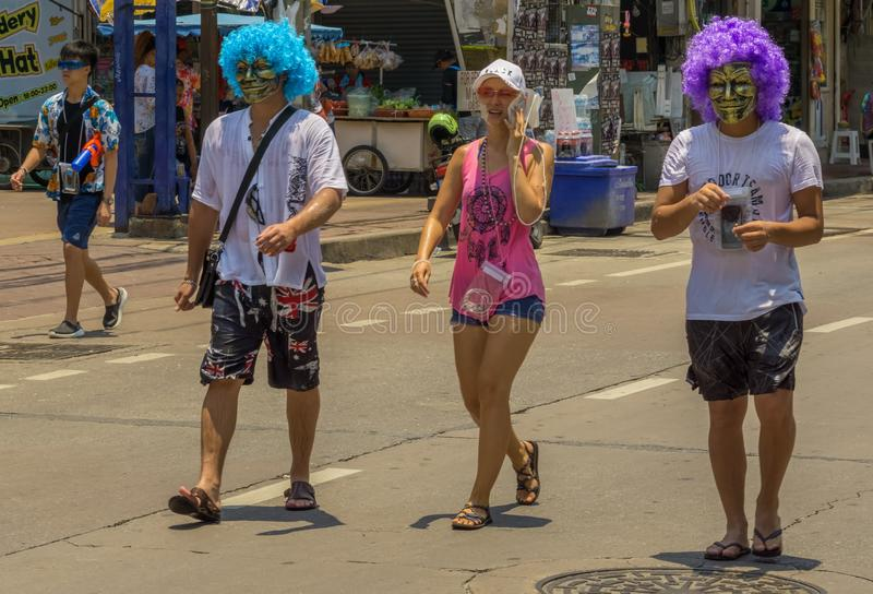 People in colorful wigs and masks were on their way to celebrate Songkran royalty free stock photos