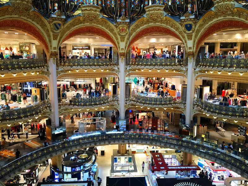 People in galeries lafayette in Paris, France. People come from all over the world in galeries lafayette stock photography