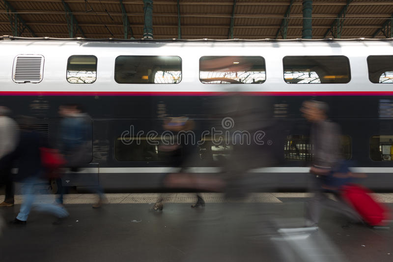 People coming to or leaving train station platform. Subway train at the station. People coming to or leaving train station platform. Motion blur. City life stock images