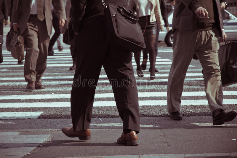 People commuting in rush hour at zebra crossing. Tokyo japan stock image