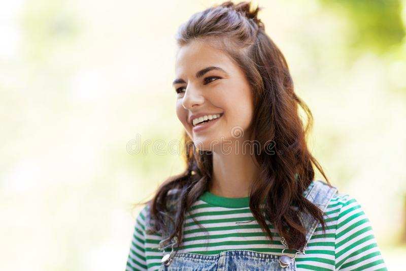 Portrait of happy young woman outdoors. People concept - portrait of happy smiling young woman outdoors royalty free stock photo