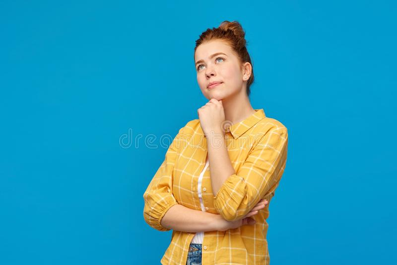Red haired teenage girl looking up and dreaming royalty free stock image