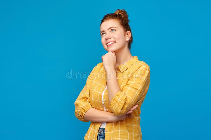 Red haired teenage girl looking up and dreaming stock photography