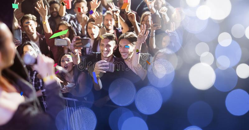 People at concert with transition. Digital composite of people at concert with transition royalty free stock photos