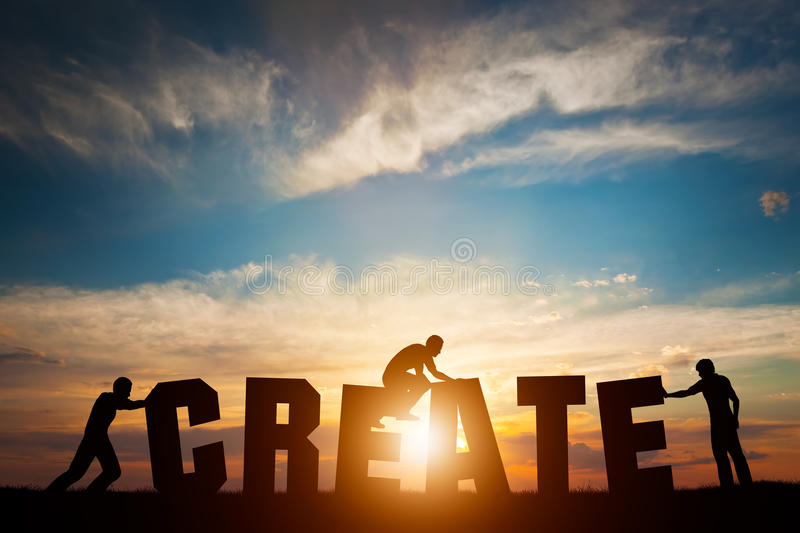 People connect letters to compose the CREATE word. Creativity, making art, teamwork royalty free stock photos