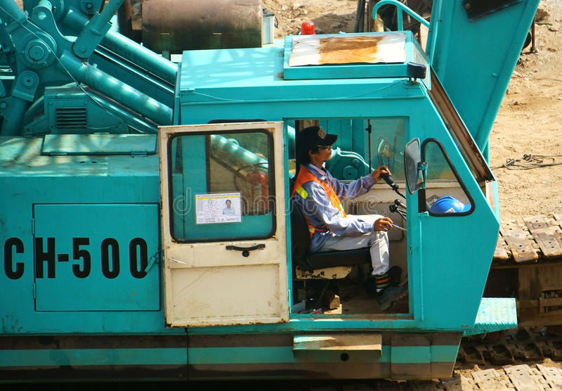 Download People control excavator editorial stock photo. Image of build - 43660713