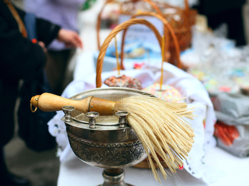 People cooked and brought to consecrate Easter cakes and eggs in the Church. Orthodox russian tradition stock image