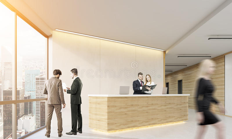 People cooperating in a wooden office stock image