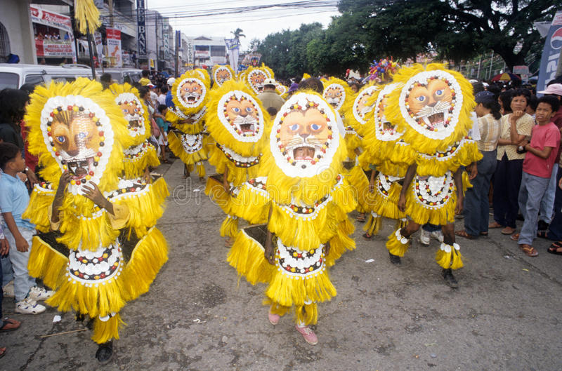 People on costumes at the parade of Ati-Atihan festival. Kalibo, Philippines - 12 Januray 1999: People on costumes at the parade of Ati-Atihan festival in Kalibo stock image