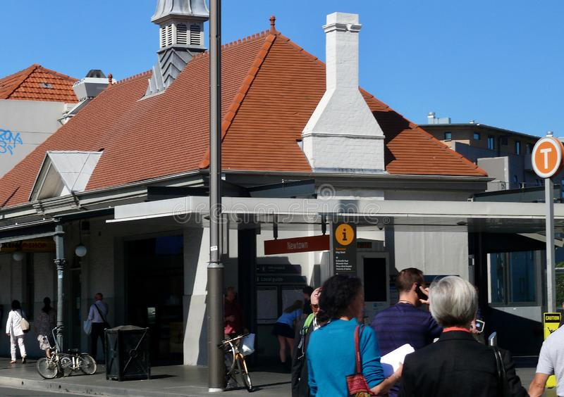 People cross King Street to get to Newtown Railway Station stock photo