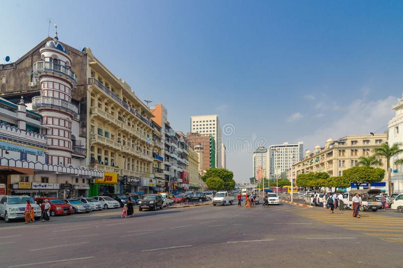 People crossing on the busy street of downtown Yangon stock photo