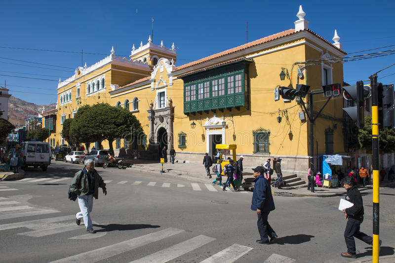 People crossing a crosswalk the city of Potosi in Bolivia. stock photo