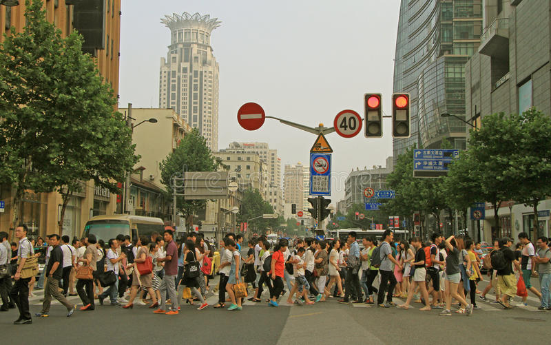 People are crossing road by crosswalk in Shanghai stock photography