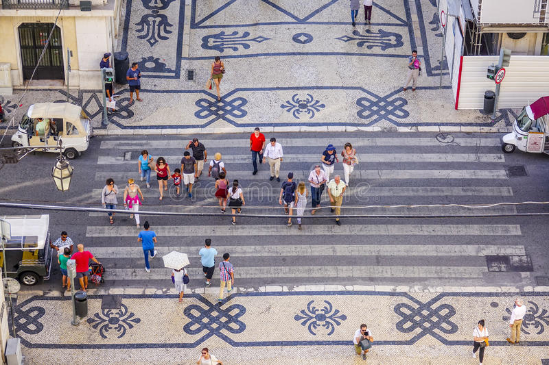 People crossing the street - aerial view from Augusta Street Arch - LISBON - PORTUGAL - JUNE 17, 2017 royalty free stock images