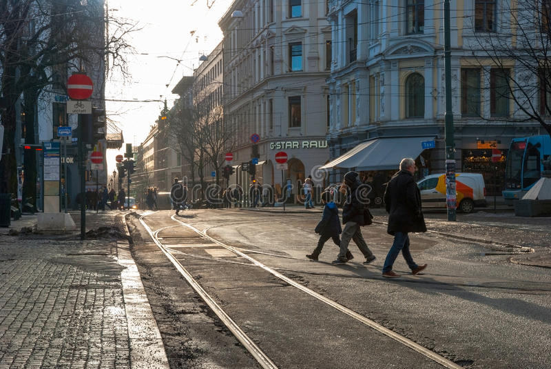 People crossing tram rails in Oslo, Norway royalty free stock photos