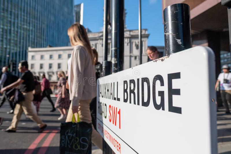 People crossing the Vauxhall Bridge road in London royalty free stock photo