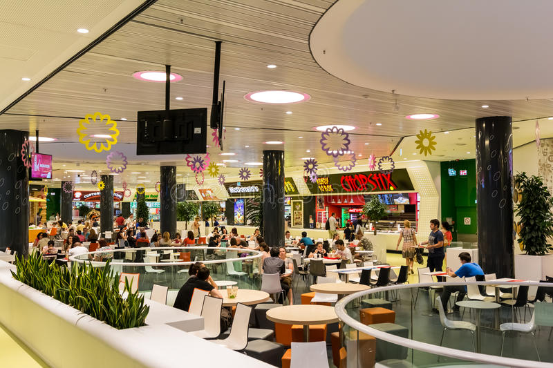People Crowd Eating Fast Food. BUCHAREST, ROMANIA - JULY 19, 2014: People Crowd Eating Fast Food On Restaurant Floor In Luxurious Shopping Mall royalty free stock image