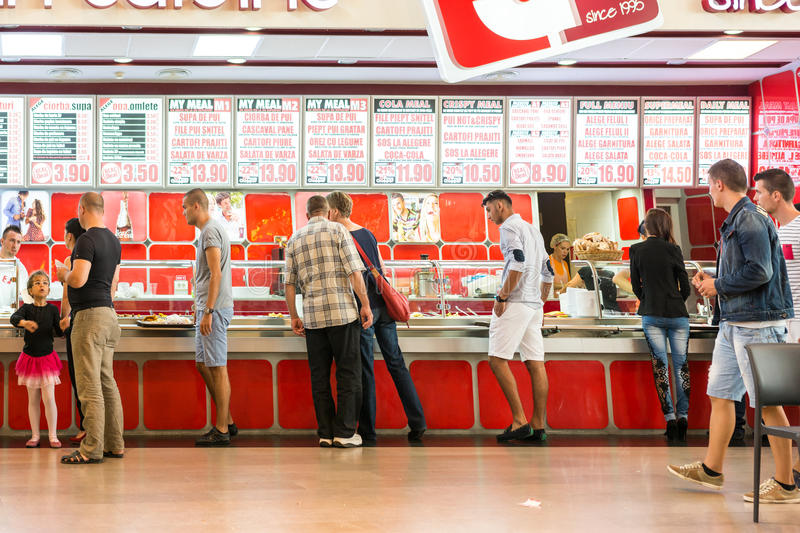 People Crowd Eating Fast Food. TIMISOARA, ROMANIA - AUGUST 24, 2014: People Crowd Eating Fast Food On Restaurant Floor In Luxurious Shopping Mall stock photos