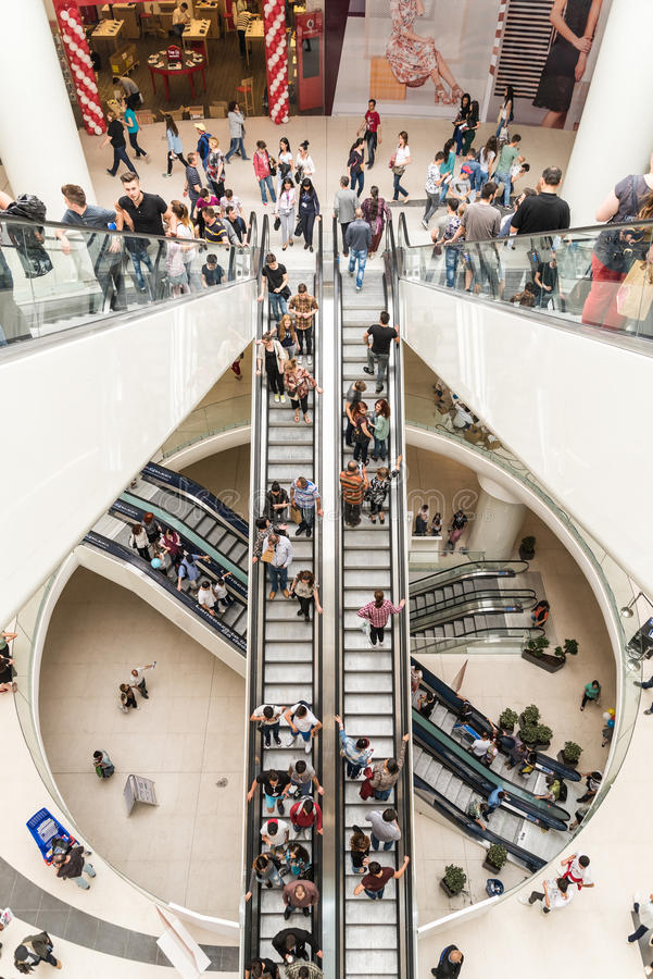 People Crowd On Escalators In Luxury Shopping Mall stock photography